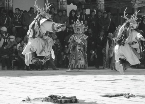 Cham-dances-at-Khumbhum-Monastery-in-Amdo-today-Qinghai-Province-to-celebrate-Losar.-486x350